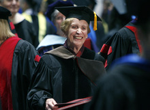 Francisco Kjolseth  |  The Salt Lake Tribune Beverley Taylor Sorenson holds her honorary degree awarded in consideration of her dedication to promoting the importance of arts as an essential part of a child's education. She received the honor at commencement ceremonies at the Huntsman Center in Salt Lake City on Friday, May 4, 2012.