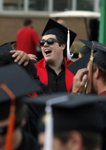 Francisco Kjolseth  |  The Salt Lake Tribune Blake Barcus tries to motivate fellow soon-to-be graduates to join him in the University of Utah chant before commencement ceremonies at the Huntsman Center in Salt Lake City on Friday, May 4, 2012.