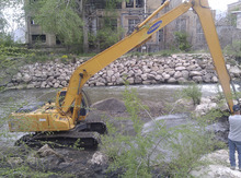 Weber County officials divert part of the Weber River with a track-hoe in an attempt to find a 4-year-old Layton boy, who fell into the river six days ago and is presumed dead. Courtesy: Weber County Sheriff's Office