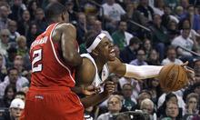 Boston Celtics forward Paul Pierce (34) yells as he slams into Atlanta Hawks defender Joe Johnson (2) during the second quarter of Game 3 of an NBA first-round playoff basketball series, Friday, May 4, 2012, in Boston. (AP Photo/Charles Krupa)