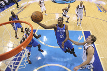 Oklahoma City Thunder forward Kevin Durant (35) shoots past Dallas Mavericks forward Dirk Nowitzki (41) of Germany during the first half of Game 4 in a first-round NBA basketball playoff series, Saturday, May 5, 2012, in Dallas. The Thunder won 103-97.  (AP Photo/Pool/ Ronald Martinez)