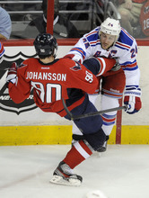 Washington Capitals center Marcus Johansson (90), of Sweden, tangles with New York Rangers right wing Ryan Callahan (24) during the first period of Game 4 of an NHL hockey Stanley Cup second-round playoff series, Saturday, May 5, 2012, in Washington. (AP Photo/Nick Wass)
