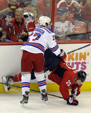 New York Rangers defenseman Ryan McDonagh (27) knocks Washington Capitals left wing Troy Brouwer (20) to the ice during the first period of Game 4 of an NHL hockey Stanley Cup second-round playoff series, Saturday, May 5, 2012, in Washington. (AP Photo/Nick Wass)