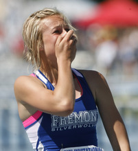 Rick Egan    The Salt Lake Tribune   Tawnie Moore, Fremont, HIgh, reacts to her record breaking time as she crosses the finish line in first place in the girls 100 meter hurdle, at the BYU Invitational track meet in Provo, Saturday, May 5, 2012.