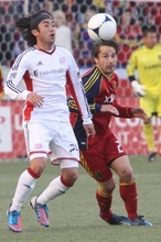 Rick Egan  | The Salt Lake Tribune   Real Salt Lake's Ned Grabavoy (20)  goes after the ball along with New England's Lee Nguyen, in MLS action, Real Salt Lake vs. New England Revolution, at Rion Tinto Stadium, Saturday, May 5, 2012.