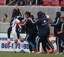 Rick Egan  | The Salt Lake Tribune   The Revolution celebrate with New England's Blake Brettschneider after he scored a goal for the Revolution, in MLS action, Real Salt Lake vs. New England Revolution, at Rio Tinto Stadium, Saturday, May 5, 2012.
