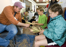 Paul Fraughton | Salt Lake Tribune  Archaeologist, Scott Whitesides helps Tristam Gaylord, 10, left and Gabriella Zipek, 10, make duck decoys made from  tule at the archaeology open house Saturday at the Utah  State History Museum at the Rio Grande Depot. The event  was part of Archaeology Week activities that began Saturday and will run through May 12th. At the open house children participated in hands on activities with an  archaeological theme.  Saturday, May 5, 2012