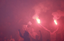 Red Star soccer fans celebrate victory against Partizan Belgrade during their Serbian national soccer league derby match, in Belgrade, Serbia, Saturday, May 5, 2012. Red Star won 1-0. (AP Photo/Darko Vojinovic)