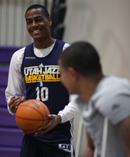Lennie Mahler  |  The Salt Lake Tribune Jazz players Alec Burks and Earl Watson chat before a practice at the Zions Bank Basketball Center on Sunday, May 6, 2012.