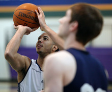 Lennie Mahler  |  The Salt Lake Tribune Devin Harris shoots around with Gordon Hayward during a practice at the Zions Bank Basketball Center on Sunday, May 6, 2012.