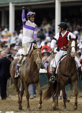 Jockey Mario Gutierrez celebrates after riding I'll Have Another to victory in the 138th Kentucky Derby horse race at Churchill Downs Saturday, May 5, 2012, in Louisville, Ky. (AP Photo/Matt Slocum)