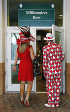 Spectators make their way to the grandstand viewing area before the 138th Kentucky Derby horse race at Churchill Downs Saturday, May 5, 2012, in Louisville, Ky. (AP Photo/James Crisp)