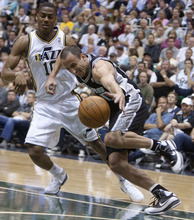 Jeremy Harmon  |  The Salt Lake Tribune  Alec Burks defends Manu Ginobili as the Jazz host the Spurs in the first round of the NBA playoffs at EnergySolutions Arena in Salt Lake City, Saturday, May 5, 2012.