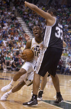 Jeremy Harmon  |  The Salt Lake Tribune  Alec Burks is fouled by Boris Diaw as the Jazz host the Spurs in the first round of the NBA playoffs at EnergySolutions Arena in Salt Lake City, Saturday, May 5, 2012.