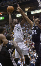 Jeremy Harmon  |  The Salt Lake Tribune  Al Jefferson shoots over Tim Duncan as the Jazz host the Spurs in the first round of the NBA playoffs at EnergySolutions Arena in Salt Lake City, Saturday, May 5, 2012.