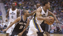 Jeremy Harmon  |  The Salt Lake Tribune  Devin Harris drives around Tony Parker and Kawhi Leonard as the Jazz host the Spurs in the first round of the NBA playoffs at EnergySolutions Arena in Salt Lake City, Saturday, May 5, 2012.