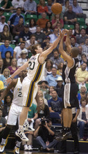 Jeremy Harmon  |  The Salt Lake Tribune  Gordon Hayward tries to block a shot from Tony Parker as the Jazz host the Spurs in the first round of the NBA playoffs at EnergySolutions Arena in Salt Lake City, Saturday, May 5, 2012.