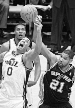 Rick Egan  | The Salt Lake Tribune   Utah Jazz forward Enes Kanter (0) goes for the ball along with San Antonio Spurs center Tim Duncan (21), in NBA playoff action at the EnergySolutions Arena, Saturday, May 5, 2012.