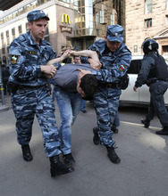 Police detain a protester in downtown Moscow shortly before Vladimir Putin's inauguration Monday, May 7, 2012. Putin's inauguration on Monday comes a day after an opposition protest drew more than 20,000 people, fewer than the mass demonstrations that preceded his election but still a sign that the anger over Putin's return to the Kremlin has not faded. (AP Photo/Ivan Secretarev)