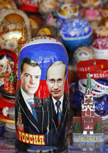 A Russian traditional wooden Matreshka doll depicting outgoing Russian President Dmitry Medvedev, left, and president elect, now Prime Minister Vladimir Putin, is displayed by a street vendor in downtown Moscow, Russia, Friday, May 4, 2012. Vladimir Putin will be sworn in on May 7, as a new president.(AP Photo/Misha Japaridze)