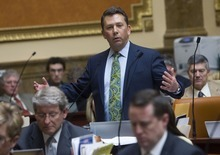 AL HARTMANN  |  The Salt Lake Tribune  Rep. Stephen Sandstrom, R-Orem, stands Friday for the two-hour debate over his enforcement-only immigration bill. The measure, after being amended for the second time in two weeks passed the House overwhelmingly, 58-15. It now goes to the Senate.