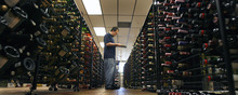 Holladay - Chris Brown, a Holladay State Liquor Store employee, takes notes on what wines need restocking Aug. 27, 2008. Steve Griffin/The Salt Lake Tribune