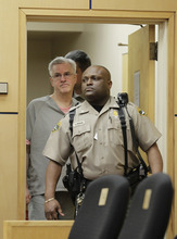 Steve Powell is led into in a Pierce County Superior Court hearing, Monday, April 23, 2012, in Tacoma, Wash. Powell's attorney said Monday that investigators frustrated by their unsuccessful quest to find Powell's missing daughter-in-law pursued an