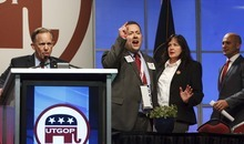Leah Hogsten  |  The Salt Lake Tribune Second Congressional District candidate Chuck Williams (left) and one of Williams' staffers (right) are angry after Williams' mic was shut off for calling fellow candidate Chris Stewart a