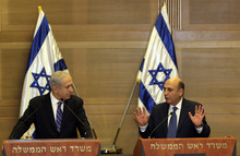 Israel's Prime Minister Benjamin Netanyahu, left, and Kadima party leader Shaul Mofaz hold a joint press conference announcing the new coalition government, in Jerusalem, Tuesday, May 8, 2012. Netanyahu said Tuesday his new coalition government will promote a