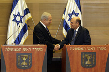 Israel's Prime Minister Benjamin Netanyahu, left, and Kadima party leader Shaul Mofaz shake hands before holding a joint press conference announcing the new coalition government, in Jerusalem, Tuesday, May 8, 2012. Netanyahu said Tuesday his new coalition government will promote a