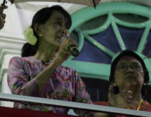 Myanmar Opposition leader Aung San Suu Kyi, left, talks to supporters during an opening ceremony of a branch office of her National League for Democracy (NLD) party on Monday, May 7, 2012, in Yangon, Myanmar. (AP Photo/Khin Maung Win)