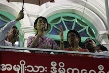 Myanmar Opposition leader Aung San Suu Kyi, centre, talks to supporters during an opening ceremony of a branch office of her National League for Democracy (NLD) party on Monday, May 7, 2012, in Yangon, Myanmar. (AP Photo/Khin Maung Win)