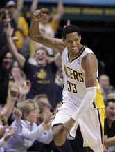 Indiana Pacers forward Danny Granger celebrates a 3-point basket in the first half of Game 5 of an NBA basketball first-round playoff series against the Orlando Magic, in Indianapolis on Tuesday, May 8, 2012. (AP Photo/Michael Conroy)