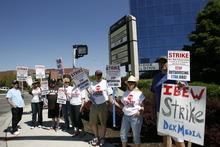 Paul Fraughton | Salt Lake Tribune Picketers from IBEW  local 1269 strike against Dex One Corp. in Salt Lake on Tuesday, May 8, 2012.