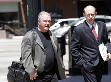 Al Hartmann  |  The Salt Lake Tribune Developer Terry Diehl, left,  enters U.S. Trustee Office hearing Tuesday May 8 in Salt Lake City.  He faced his creditors at a bankruptcy trustee hearing.