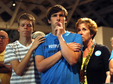 Seth Keel, center, is consoled by his boyfriend, Ian Chambers, left, and his mother Jill Hinton, during a concession speech at an Amendment One opposition party Tuesday, May 8, 2012, at The Stockroom at 230 in downtown Raleigh, N.C. North Carolina voters approved the constitutional amendment Tuesday defining marriage solely as a union between a man and a woman, becoming the latest state to effectively slam the door shut on same-sex marriages. (AP Photo/The News & Observer, Travis Long)