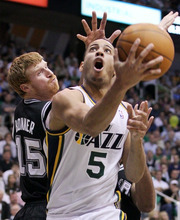 Utah Jazz guard Devin Harris (5) attempts to score past San Antonio Spurs forward Matt Bonner (15) during the second half of Game 4 in the first-round NBA basketball playoff series, Monday, May 7, 2012, in Salt Lake City. The Spurs defeated the Jazz 87-81 to take the series 4-0. (AP Photo/Colin E Braley)