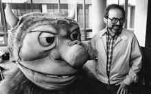 In this Sept. 25, 1985 file photo, author Maurice Sendak poses with one of the characters from his book