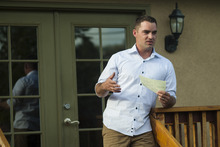Chris Detrick     The Salt Lake Tribune Navy veteran Dillon Ely talks about his experiences in the military during a gathering at professor Maximilian Werner's house Tuesday April 24, 2012.