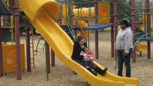 Courtesy photo Taylor Walters goes down slide with Neveah as Lindsay Batts watches.