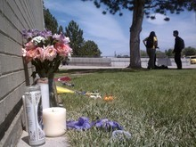 Leah Hogsten | The Salt Lake Tribune Flowers are left in memory of Jacob Armijo and Avery Bock at Hunter High School in West Valley City on Thursday. The students died Wednesday in a car crash a block from the school. Two other students in the car, and a woman in another car, were injured.