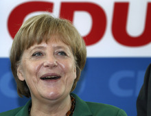German Chancellor Angela Merkel laughs as she arrives for a board meeting of the German Christian Democratic party in Berlin, Germany, Monday, May 7, 2012. Voters in Germany's northernmost state on Sunday ousted a governing center-right government made up of the same parties as Chancellor Angela Merkel's federal coalition, according to official results. For Merkel, the defeat of her local allies in Schleswig-Holstein state could be an omen of worse to come. Elections are due in North-Rhine Westphalia state _ the country's most populous with 18 million inhabitants _ where her party also risks losing power, according to recent polls. (AP Photo/Michael Sohn)