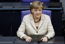 German Chancellor Angela Merkel attends a meeting of the German federal parliament Bundestag in Berlin, Germany, Thursday, May 10, 2012. (AP Photo/Michael Sohn)