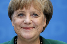 German Chancellor Angela Merkel smiles during a press conference after a board meeting of the German Christian Democratic party in Berlin, Germany, Monday, May 7, 2012. Voters in Germany's northernmost state on Sunday ousted a governing center-right government made up of the same parties as Chancellor Angela Merkel's federal coalition, according to official results. For Merkel, the defeat of her local allies in Schleswig-Holstein state could be an omen of worse to come. Elections are due in North-Rhine Westphalia state - the country's most populous with 18 million inhabitants - where her party also risks losing power, according to recent polls. (AP Photo/Michael Sohn)