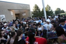 Kim Raff | The Salt Lake Tribune Family and friends of Jacob Armijo and Avery Bock, who died in a car accident earlier in the day, gather at a vigil at Hunter High School in West Valley City, Utah on May 9, 2012.