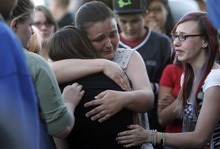 Kim Raff | The Salt Lake Tribune (black middle) Kasena Marshall is comforted by Jessica Leishman after hearing news another teen may have died duirng a vigil for Jacob Armijo and Avery Bock, who died in a car accident earlier in the day at Hunter High School in West Valley City, Utah on May 9, 2012.