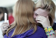 Kim Raff | The Salt Lake Tribune  Cheryl Rasmussen is comforted during a vigil for Jacob Armijo and Avery Bock, who died in a car accident earlier in the day at Hunter High School in West Valley City, Utah on May 9, 2012.