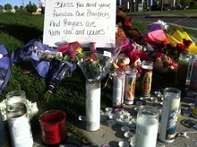 LeGrande Jolley | The Salt Lake Tribune Candles, signs and flowers are set up outside Hunter High School in tribute to two students who died in a traffic accident on Wednesday.