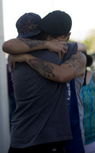 Kim Raff | The Salt Lake Tribune (back) Dom Montoya and Kelli Etcheverry embrace during a vigil for Jacob Armijo and Avery Bock, who died in a car accident earlier in the day at Hunter High School in West Valley City, Utah on May 9, 2012.