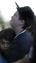 Kim Raff | The Salt Lake Tribune (top) Triston Harms and (bottom) Peace Pulido comfort each other during a vigil for Jacob Armijo and Avery Bock, who died in a car accident earlier in the day, at Hunter High School in West Valley City, Utah on May 9, 2012.